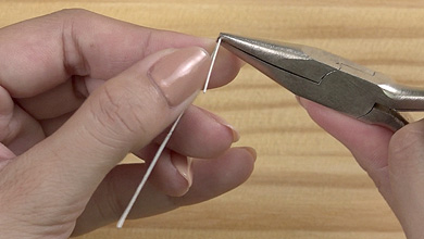 Use pliers to bend the wire at the marks at each end.